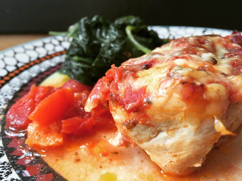 Cheesy Italian chicken bake with a warm spinach salad