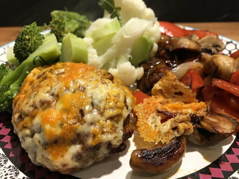 Cheesy turkey burger with stir fried vegetables