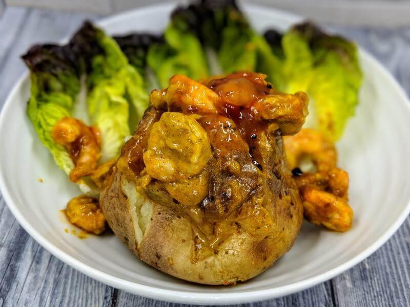 Coronation king prawn topped baked potato
