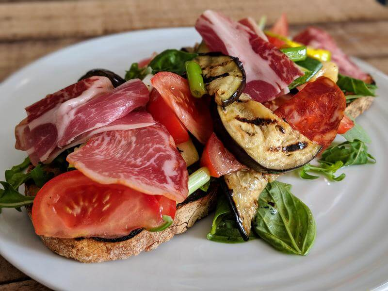Spanish deli meat and grilled vegetable bruschetta